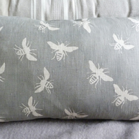 hand printed  muted grey little bees cushion