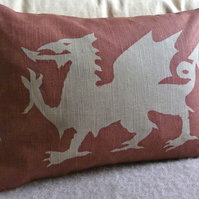 hand printed muted red dragon cushion