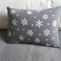 Hand printed grey blue snowflake cushion