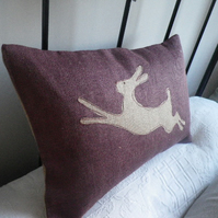 hand printed muted mulberry leaping hare cushion