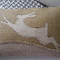 hand printed leaping hessian leaping hare cushion