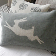 hand printed sage leaf blue leaping hare cushion