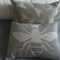 Hand printed Queen bee and little bees cushion pair