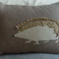 hand printed and appliqued Elvis the hedgehog cushion