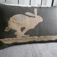 handprinted rustic hessian hare cushion with applique detailing