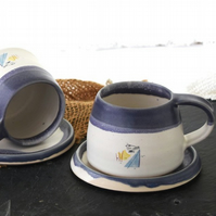 Handmade coast inspired blue and white ceramic cup and saucer set