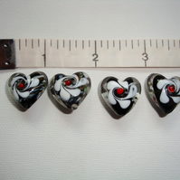 Black glass heart beads x 4