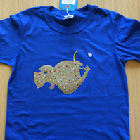Angler fish appliquéd blue T-shirt for child aged 7-8 years