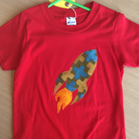 Rocket appliquéd red T-shirt for child aged 5-6 years