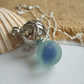 Sea glass marble necklace, blue cat's eye marble in silver plated pendant, swirl