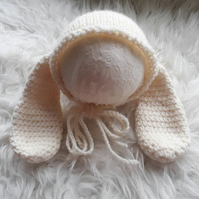 Cream knitted rabbit hat for newborn baby. Easter photography props.