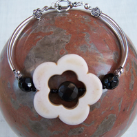 Howlite White Flower and Black Obsidian Bracelet with Silver Tone Curved Tubes