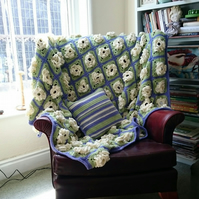 A crocheted throw of many big and blowsy blooms