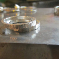 Two textured wedding rings for men and women in recycled 18ct white gold