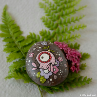 painted pebble - pink bird and blossom