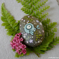 painted pebble - blue bird and blossom