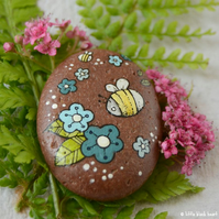 painted pebble - bee and blue flowers