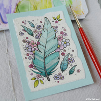floating blue feathers and flowers - original aceo