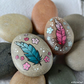 painted pebbles -feather pair