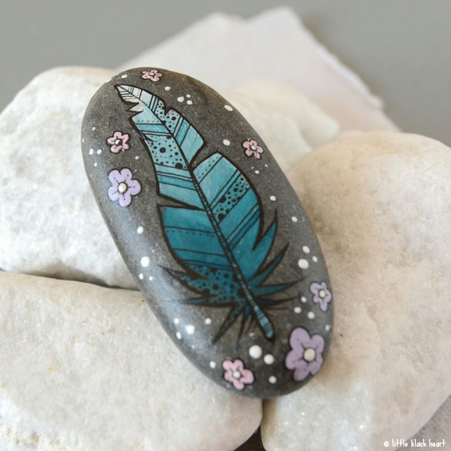 fancy blue feather - painted pebble