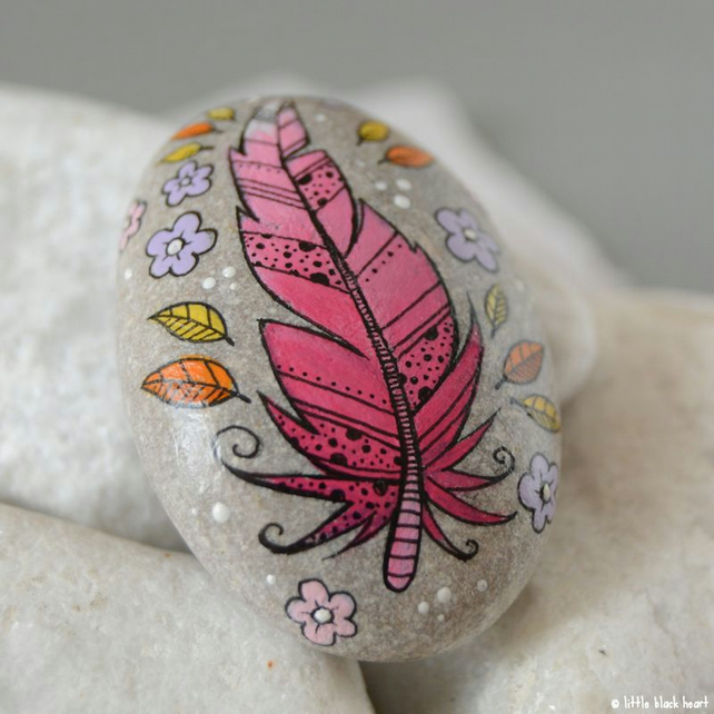 fancy pink feather - painted pebble