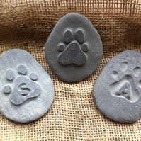 Hand carved & personalised memory stone, with a paw print in various designs