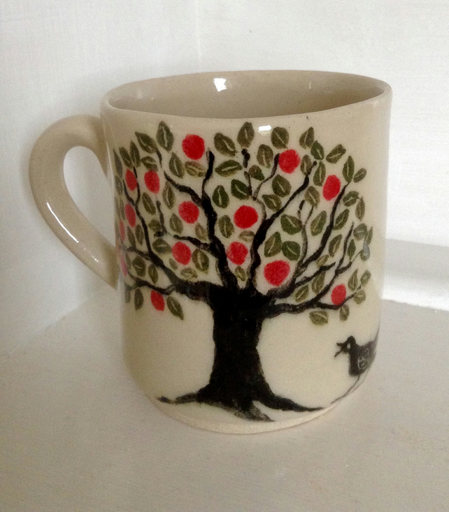 Half pint mug decorated with hand painted apple tree and blackbird design