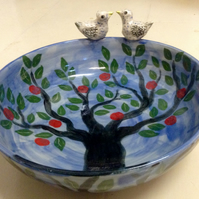 Blue bowl with tree decoration and sculpted birds