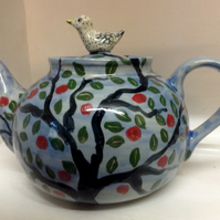 Blue one litre teapot with apple tree design and bird lid