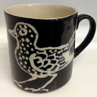 Mug with bird decoration holding half pint