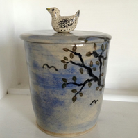 Storage jar decorated with blue sky and tree and with bird lid