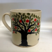 Mug, holding half a pint, with apple tree and blackbird design