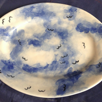 Oval platter with cloud and birds decoration