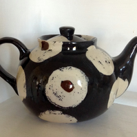 Teapot with black and white abstract design