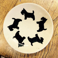 Plate in cream stoneware decorated with Scottie dogs. Free UK postage
