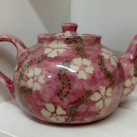 Teapot in stoneware clay with pink and green floral decoration. Free UK postage