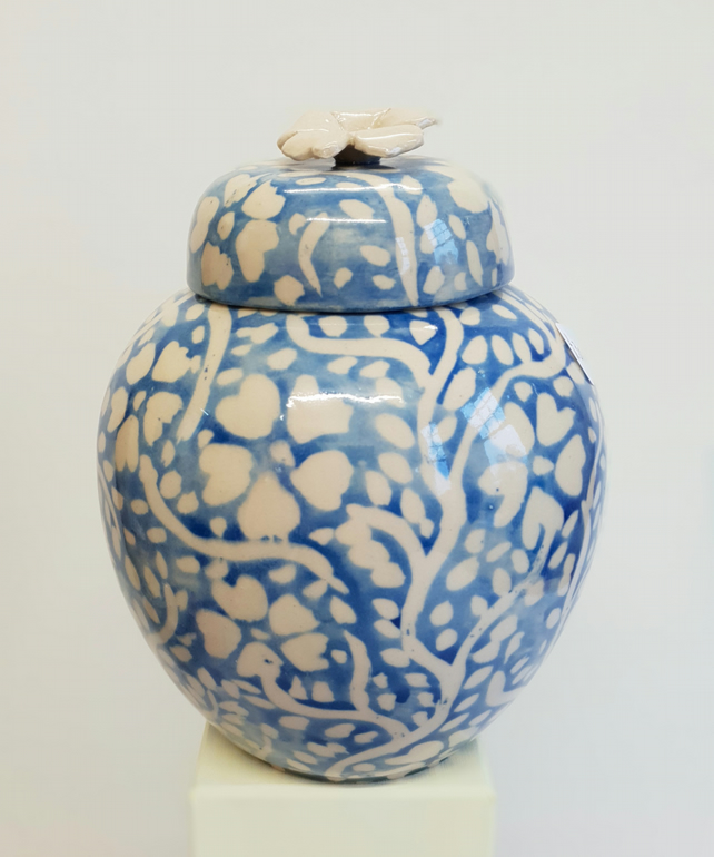 Storage jar or container in cream stoneware with blue and white floral design