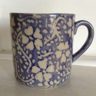 Mug in pottery stoneware with floral design