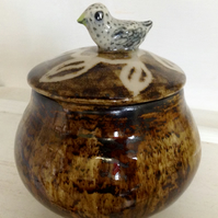 Jar with lid and bird