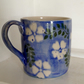 Mug with floral decoration
