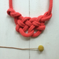 Coral longhorn knot necklace