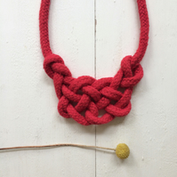 Red longhorn knot necklace