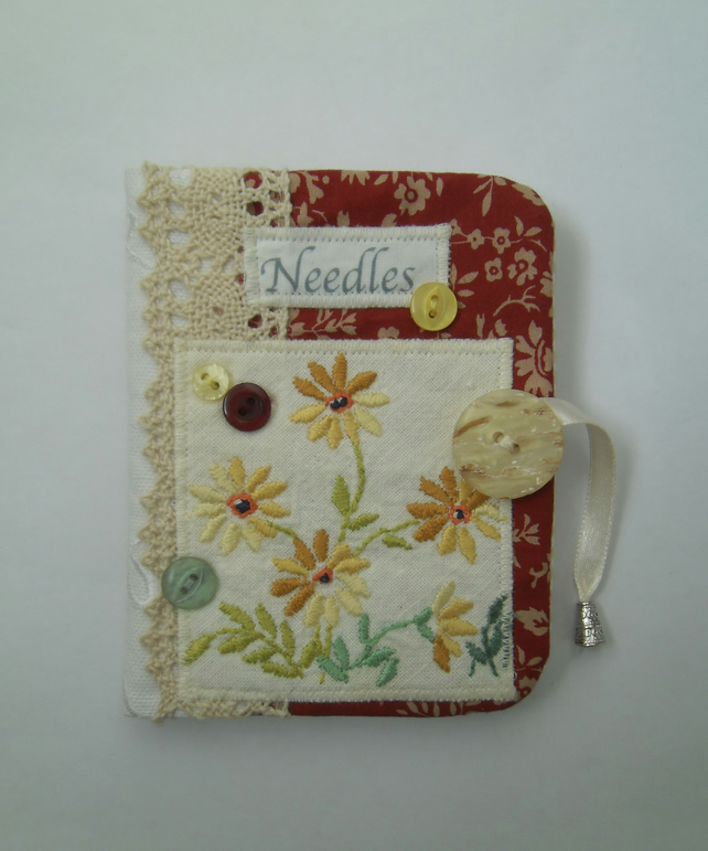 Sewing needle case with yellow repurposed embroidery