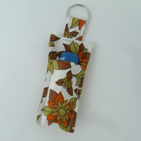 Key ring with a lip balm made from vintage fabric