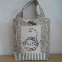 Green fabric hand bag small tote bag with vintage embroidered flowers.