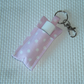 Key ring lip balm holder in pink fabric