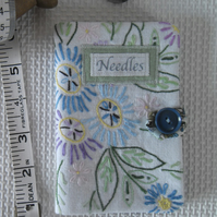 Sewing needle case with repurposed embroidery green