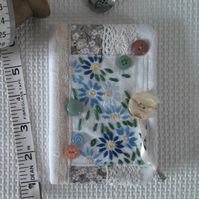 Sewing needle case with repurposed embroidery blue