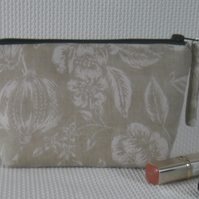 Zipped make up bag in green fabric with pink lining