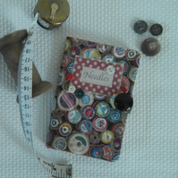 Sewing needle case in cotton reel theme fabric